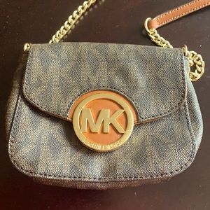 Michael Kors snap front hipster purse